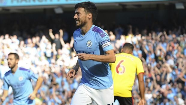 Manchester City's David Silva celebrates after scoring his sides first goal during the English Premier League soccer match between Manchester City and Watford at Etihad stadium in Manchester, England, Saturday, Sept. 21, 2019. (AP Photo/Rui Vieira)
