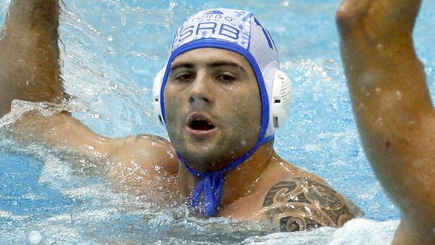 Serbia's Aleksandar Sapic holds the ball during the men's FINA Water Polo World League Final between Serbia and Hungary in Berlin, Sunday Aug. 12, 2007. Serbia defeated Hungary by 9-6. (AP Photo/Michael Sohn)
