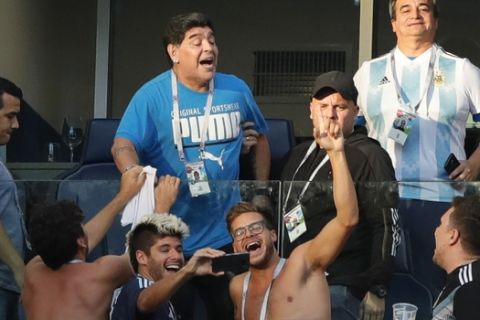 Argentinian soccer former player Diego Armando Maradona stands on the tribune during the group D match between Argentina and Nigeria, at the 2018 soccer World Cup in the St. Petersburg Stadium in St. Petersburg, Russia, Tuesday, June 26, 2018. (AP Photo/Ricardo Mazalan)