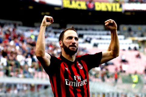 AC Milan's Gonzalo Higuain celebrates after scoring his side's opening goal during the Serie A soccer match between AC Milan and Chievo Verona at the San Siro Stadium, in Milan, Italy, Sunday, Oct. 7, 2018. (AP Photo/Antonio Calanni)
