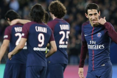 PSG's Angel Di Maria, right, celebrates scoring his side's fifth goal during the French League One soccer match between Paris Saint Germain and Monaco at the Parc des Princes stadium in Paris, Sunday, April 15, 2018. (AP Photo/Thibault Camus)