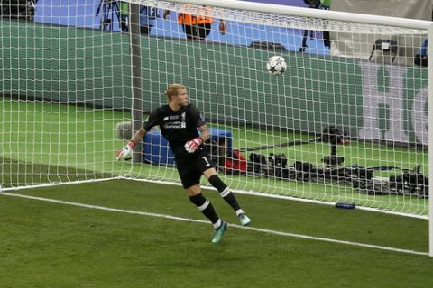 Liverpool goalkeeper Loris Karius looks at the ball after Real Madrid's Gareth Bale scored his side's 3rd goal during the Champions League Final soccer match between Real Madrid and Liverpool at the Olimpiyskiy Stadium in Kiev, Ukraine, Saturday, May 26, 2018. (AP Photo/Darko Vojinovic)
