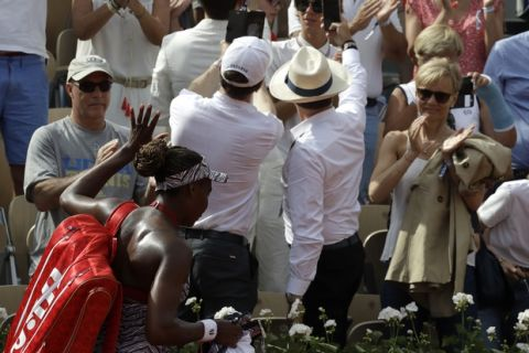 Venus Williams of the U.S. leaves the court after losing to China's Qiang Wang during their first round match of the French Open tennis tournament at the Roland Garros Stadium, Sunday, May 27, 2018 in Paris. (AP Photo/Alessandra Tarantino)
