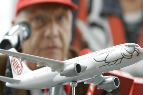 """FILE - In this Sept. 14, 2009 file photo former Formula One champion and then head of the airline """"Fly Niki"""" Niki Lauda speaks behind an airplane model during a news conference about expansion plans in Vienna. Austrian media reported Tuesday, Jan. 23, 2018 that the board of creditors allowed Niki Lauda to buy Austrian Niki airline which had become a daughter of insolvent German airline Air Berlin. (AP Photo/Lilli Strauss, file)"""