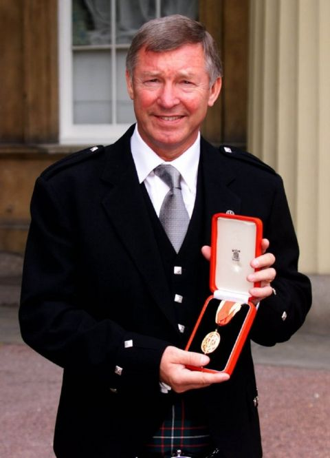 Manchester United manager Alex Ferguson, who received a knighthood from the Queen, during an Investiture ceremony at Buckingham Palace.