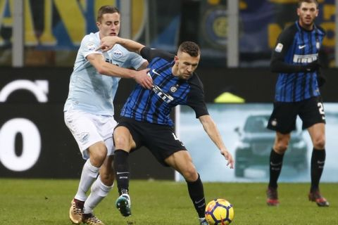 Inter Milan's Ivan Perisic, right, is challenged by Lazio's Adam Marusic during the Serie A soccer match between Inter Milan and Lazio, at the Milan's San Siro stadium, Italy, Saturday, Dec. 30, 2017. (AP Photo/Antonio Calanni)