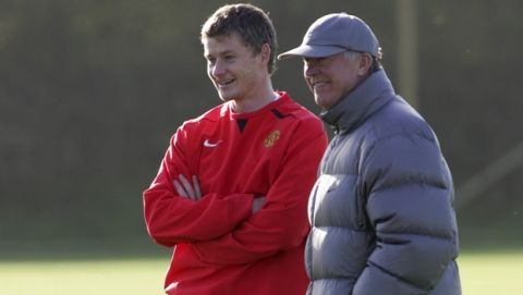 Manchester United's manager Alex Ferguson, right, and striker Ole Gunnar Solskjaer are seen during a training session at the side's Carrington training ground, in Manchester, England, Tuesday Nov. 6, 2007, prior to their Champions League Group F soccer match against Dynamo Kiev on Wednesday. (AP Photo/Simon Pendrigh)
