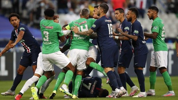Players scrum after PSG's Kylian Mbappe, center down, was tackled during the French Cup soccer final match between Paris Saint Germain and Saint Etienne at Stade de France stadium, in Saint Denis, north of Paris, Friday July 24, 2020. (AP Photo/Francois Mori)