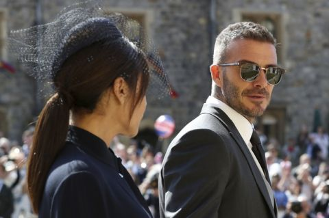 David Beckham and Victoria Beckham arrive for the wedding ceremony of Prince Harry and Meghan Markle at St. George's Chapel in Windsor Castle in Windsor, near London, England, Saturday, May 19, 2018. (Gareth Fuller/pool photo via AP)
