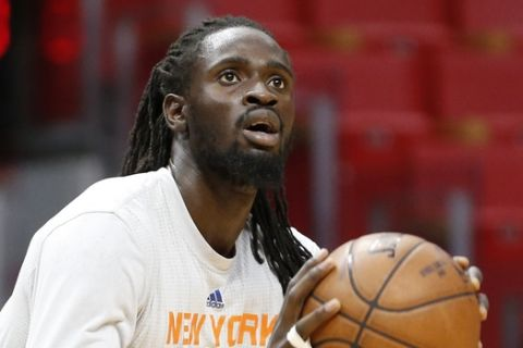 New York Knicks Maurice Ndour (2) warms up prior to an NBA basketball game against the Miami Heat, Friday, March 31, 2017, in Miami. The Knicks defeated the Heat 98-94. (AP Photo/Joel Auerbach)