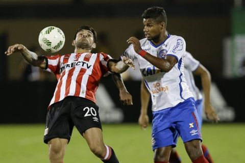 Bahia's Matheus Reis, right, tries to get to the ball from Estudiantes' Javier Toledo (20) during the second half of a Florida Cup soccer match, Sunday, Jan. 15, 2017, in Orlando, Fla. (AP Photo/John Raoux)