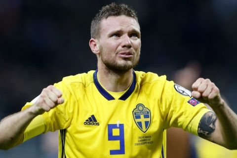 Sweden's Marcus Berg celebrates at the end of the World Cup qualifying play-off second leg soccer match between Italy and Sweden, at the Milan San Siro stadium, Italy, Monday, Nov. 13, 2017. Four-time champion Italy has failed to qualify for World Cup; Sweden advances with 1-0 aggregate win in playoff. (AP Photo/Antonio Calanni)