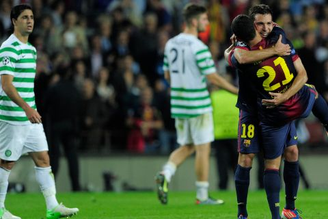 Barcelona's defender Jordi Alba (R) is congratuled by his teammate Brazilian defender Adriano Correia (R) after scoring in the last minute of the UEFA Champions League football match FC Barcelona vs Celtic CF on October 23, 2012 at the Camp Nou stadium in Barcelona.  AFP PHOTO/ JOSEP LAGO        (Photo credit should read JOSEP LAGO/AFP/Getty Images)