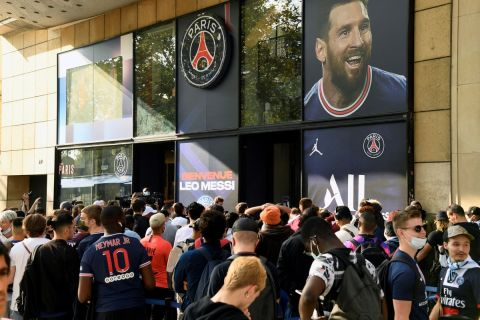 People line up to buy Argentinian football player Lionel Messi's PSG new jersey outside the Paris-Saint-Germain (PSG) football club store on the Champs Elysees avenue in Paris on August 11, 2021. Messi signed on August 10, 2021 a two-year deal with PSG with the option of an additional year. The 34-year-old will wear the number 30 in Paris, the number he had when he began his professional career at Barca.