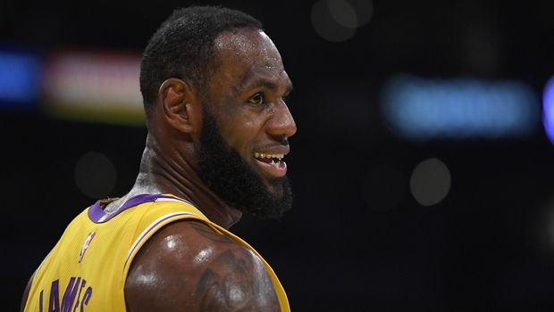 Los Angeles Lakers forward LeBron James stands on the court during the first half of an NBA basketball game against the Philadelphia 76ers Tuesday, March 3, 2020, in Los Angeles. (AP Photo/Mark J. Terrill)