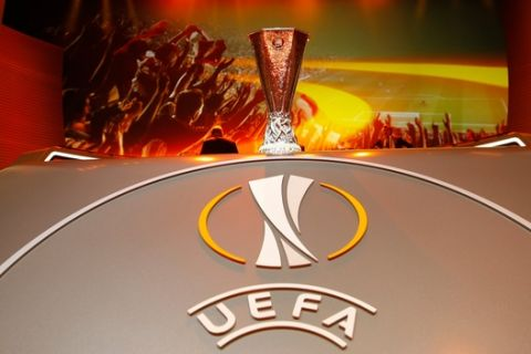 The Europa League trophy is displayed, during the Europa League draw ceremony of the first round of the 2015/2016 Europa League, at the Grimaldi Forum, in Monaco, Friday, Aug. 28, 2015. (AP Photo/Claude Paris)