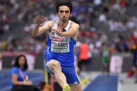 Greece's Dimitrios Tsiamis makes an attempt in the men's triple jump final at the European Athletics Championships in the Olympic stadium in Berlin, Germany, Sunday, Aug. 12, 2018. (AP Photo/Martin Meissner)
