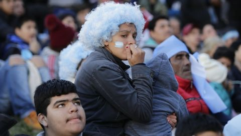 Argentina fans react in disbelief at the end of a televised broadcast of the Croatia vs. Argentina World Cup soccer match, in Buenos Aires, Argentina, Thursday, June 21, 2018. Argentina lost 3-0 to Croatia. (AP Photo Jorge Saenz)