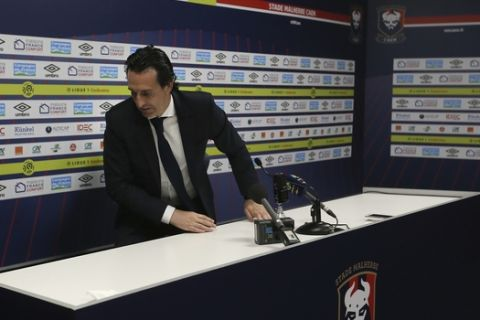 PSG head coach Unai Emery stands up at the end of his last press conference of his League One soccer match between Caen and Paris Saint-Germain at the Michel d'Ornano stadium in Caen, western France, Saturday, May 19, 2018. This is his last match with the PSG team. German coach Thomas Tuchel will replace him for the next season. (AP Photo/David Vincent)