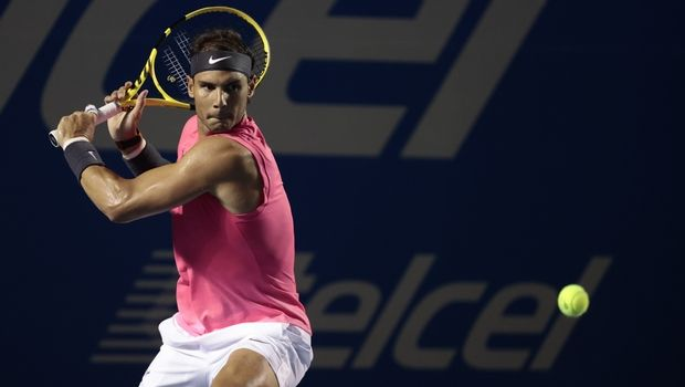 Spain's Rafael Nadal prepares to hit a backhand to Taylor Fritz, of the United States, in the men's final at the Mexican Open tennis tournament in Acapulco, Mexico, Saturday, Feb. 29, 2020. (AP Photo/Rebecca Blackwell)