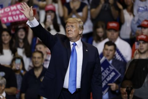 President Donald Trump departs from a campaign rally, Thursday, Aug. 2, 2018, in Wilkes-Barre, Pa. (AP Photo/Matt Rourke)