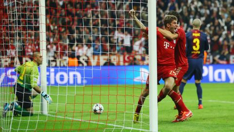 MUNICH, GERMANY - APRIL 23:  Thomas Mueller of Bayern Muenchen celebrates scoring the opening goal during the UEFA Champions League Semi Final First Leg match between FC Bayern Muenchen and Barcelona at Allianz Arena on April 23, 2013 in Munich, Germany.  (Photo by Christof Koepsel/Bongarts/Getty Images)