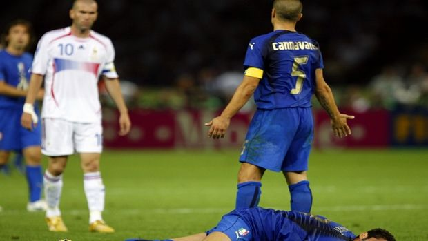 FILE - In this Sunday, July 9, 2006 file photo, France's Zinedine Zidane, left, looks on after butting Italy's Marco Materazzi, on ground, in the chest as Italy's Fabio Cannavaro, right, reacts during extra time in the final of the soccer World Cup between Italy and France in the Olympic Stadium in Berlin.  Four years after reaching the World Cup final, Italy's Azzurri and France's Les Bleus appear to have a bad case of the blues just days ahead of their opening matches. Critics say there will be no way either will play in the final on July 11 at Soccer City. Both world champion Italy and runner-up France only need to look at history and realize  been there, done that. (AP Photo/Jasper Juinen)