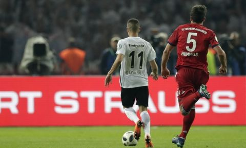 Frankfurt's Mijat Gacinovic scores his side's third goal during the German soccer cup final match between FC Bayern Munich and Eintracht Frankfurt in Berlin, Germany, Saturday, May 19, 2018. (AP Photo/Michael Sohn)