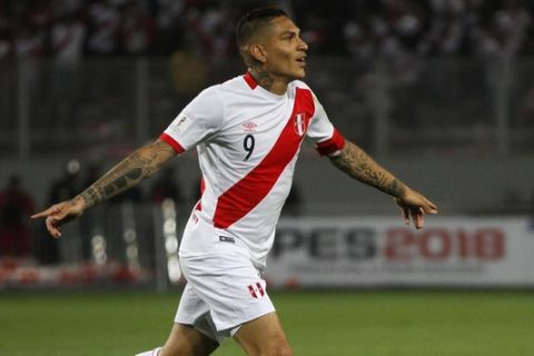 Peru's Paolo Guerrero celebrates after scoring against Colombia during a 2018 World Cup qualifying soccer match in Lima, Peru, Tuesday, Oct. 10, 2017.(AP Photo/Rodrigo Abd)