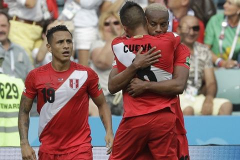 Peru's Andre Carrillo, right, celebrates with Peru's Yoshimar Yotun, left and Peru's Christian Cueva, after scoring his side's opening goal during the group C match between Australia and Peru, at the 2018 soccer World Cup in the Fisht Stadium in Sochi, Russia, Tuesday, June 26, 2018. (AP Photo/Gregorio Borgia)