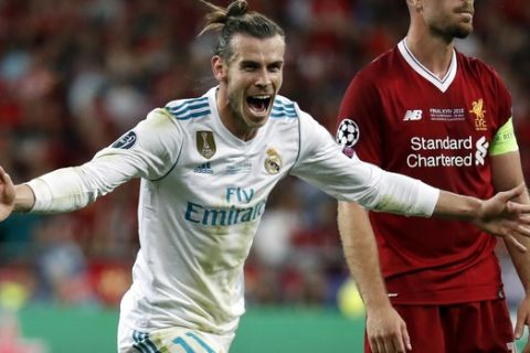 Real Madrid's Gareth Bale celebrates after scoring his side's third goal during the Champions League Final soccer match between Real Madrid and Liverpool at the Olimpiyskiy Stadium in Kiev, Ukraine, Saturday, May 26, 2018. (AP Photo/Pavel Golovkin)