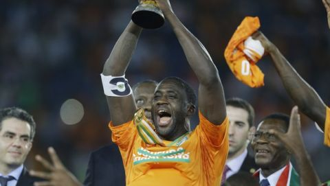 Ivory Coast's Yaya Toure, center, holds up the trophy after winning the African Cup of Nations final soccer match against Ghana in Bata, Equatorial Guinea, Sunday, Feb. 8, 2015. (AP Photo/Sunday Alamba)