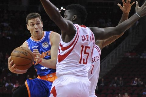 The Shanghai Sharks Jimmer Fredette, left, drives by the Houston Rockets Clint Cappella, right,  in the first half of an NBA basketball exhibition game Sunday, Oct. 2, 2016, in Houston. (AP Photo/George Bridges)