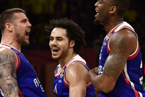 Anadolu's Adrien Moerman, left, Shane Larkin, center, and James Anderson celebrate during the Euroleague Final Four semifinal basketball match between Anadolu Efes Istanbul and Fenerbahce Beko Istanbul at the Fernando Buesa Arena in Vitoria, Spain, Friday, May 17, 2019. (AP Photo/Alvaro Barrientos)