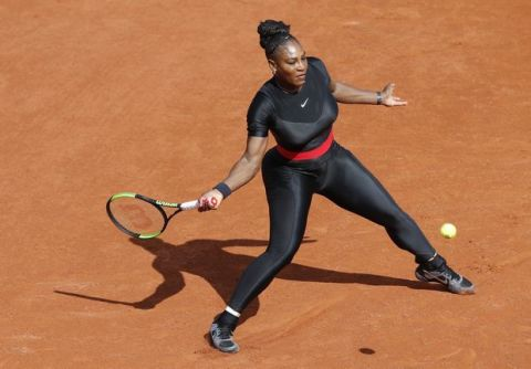 Serena Williams of the U.S. returns a shot against Krystyna Pliskova of the Czech Republic during their first round match of the French Open tennis tournament at the Roland Garros stadium in Paris, France, Tuesday, May 29, 2018. (AP Photo/Michel Euler)