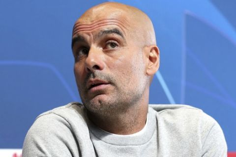 Manchester City soccer team manager Pep Guardiola during a press conference in Manchester, England, Monday Oct. 21, 2019.  Man City are scheduled to play Italy's Atalanta in a Champions League clash on Tuesday Oct. 22. (Martin Rickett/PA via AP)