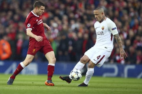 Liverpool's James Milner, left, vies for the ball with Roma's Radja Nainggolan during the Champions League semifinal, first leg, soccer match between Liverpool and AS Roma at Anfield Stadium, Liverpool, England, Tuesday, April 24, 2018. (AP Photo/Dave Thompson)