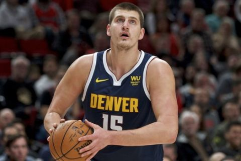 Denver Nuggets center Nikola Jokic during the first half of an NBA basketball game against the Portland Trail Blazers in Portland, Ore., Wednesday, Oct. 23, 2019. (AP Photo/Craig Mitchelldyer)