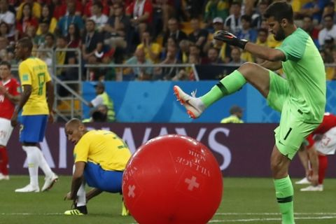 Brazil goalkeeper Alisson, right, kicks a balloon during the group E match between Brazil and Switzerland at the 2018 soccer World Cup in the Rostov Arena in Rostov-on-Don, Russia, Sunday, June 17, 2018. (AP Photo/Darko Vojinovic)