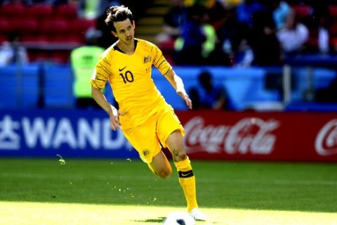 Australia's Robbie Kruse goes with the ball during the group C match between France and Australia at the 2018 soccer World Cup in the Kazan Arena in Kazan, Russia, Saturday, June 16, 2018. (AP Photo/David Vincent)