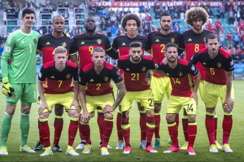Belgium's team players pose before the World Cup Group H qualifying match between Estonia and Belgium at the A. Le Coq Arena in Tallinn, Estonia, Friday, June 9, 2017. From left, first row, Kevin de Bruyne, Toby Alderweireld, Yannick Carrasco, Dries Mertens, Jan Vertonghen; from left, second row, Thibaut Courtois, Vincent Kompany, Romelu Lukaku, Axel Witsel, Nacer Chadli, Marouane Fellani. (AP Photo/Marko Mumm)