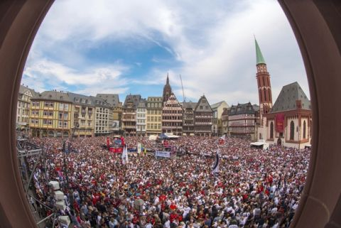 Fans of Eintracht Frankfurt soccer club crowd at Roemerberg square in Frankfurt, Germany, Sunday, May 20, 2018 to celebrate their team. Frankfurt coach Niko Kovac stunned his future employer by leading Eintracht Frankfurt to a 3-1 win over Bayern Munich in the German Cup final on Saturday in Berlin. (Andreas Arnold/Pool Photo via AP)