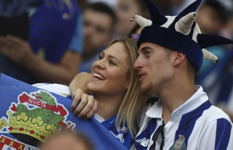 Porto fans on the stands watch the Portuguese league soccer match between FC Porto and Feirense at the Dragao stadium in Porto, Portugal, Sunday, May 6, 2018. Porto clinched the league title Saturday night, two rounds before the end, when Benfica and Sporting CP tied 0-0 in their Lisbon derby. (AP Photo/Luis Vieira)