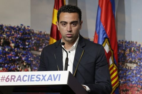 FC Barcelona Xavi Hernandez speaks  during  his farewell event at the Camp Nou stadium in Barcelona, Spain, Wednesday, June 3, 2015. FC Barcelona midfielder Xavi Hernandez says he will leave the Catalan club after 17 trophy-laden seasons in which he set club records for appearances and titles won. The 35-year-old Xavi says he will cut his contract short by one year and leave after this season to go play for Qatari club Al-Sadd on a two-year contract. (AP Photo/Manu Fernandez)