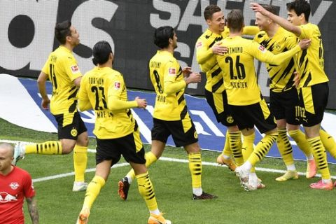 Dortmund's Marco Reus, second right, celebrates after scoring his side's opening goal during the German Bundesliga soccer match between Borussia Dortmund and RB Leipzig in Dortmund, Germany, Saturday, May 8, 2021. (AP Photo/Martin Meissner, Pool)
