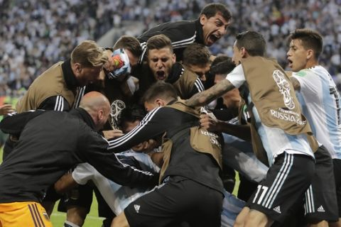 Argentina players celebrates his side's second goal by Argentina's Marcos Rojo during the group D match between Argentina and Nigeria at the 2018 soccer World Cup in the St. Petersburg Stadium in St. Petersburg, Russia, Tuesday, June 26, 2018. (AP Photo/Dmitri Lovetsky)