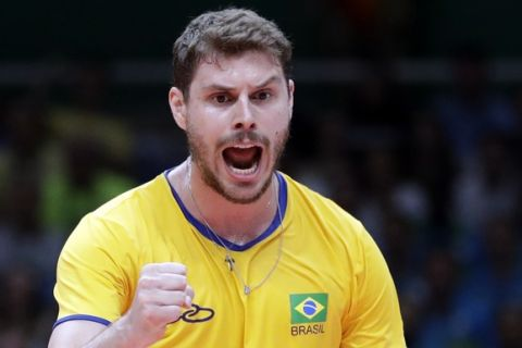 Brazil's Bruno Rezende celebrates during a men's preliminary volleyball match against Canada at the 2016 Summer Olympics in Rio de Janeiro, Brazil, Tuesday, Aug. 9, 2016. (AP Photo/Jeff Roberson)