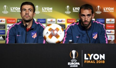 Gabi Fernandez, left, and Diego Godin of Atletico Madrid look on during a press conference at the Groupama stadium in Lyon, central France, Tuesday May, 15, 2018 ahead of the the UEFA Europa League Final against Olympique Marseille. (UEFA, Pool via AP)