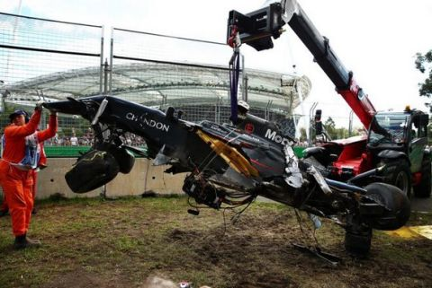 MELBOURNE, AUSTRALIA - MARCH 20: The wreckage of Fernando Alonso of Spain and McLaren Honda gets moved to the side of the track during the Australian Formula One Grand Prix at Albert Park on March 20, 2016 in Melbourne, Australia.  (Photo by Robert Cianflone/Getty Images)