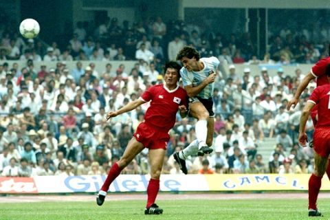Oscar Alfredo Ruggeri of Argentina, vainly guarded by South Korea's Jong-Hwan Jung, heads the ball to score the second goal for his team in their World Cup game, June 2, 1986, in Mexico City.  (AP Photo)
